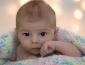 This picture was taken was taken during the first set.  She was wide awake, not quite fighting sleep, just being curious!